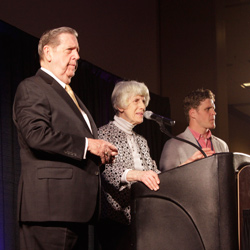 Elder Holland, Pamela Atkinson, and Clay Olsen take questions from the audience.